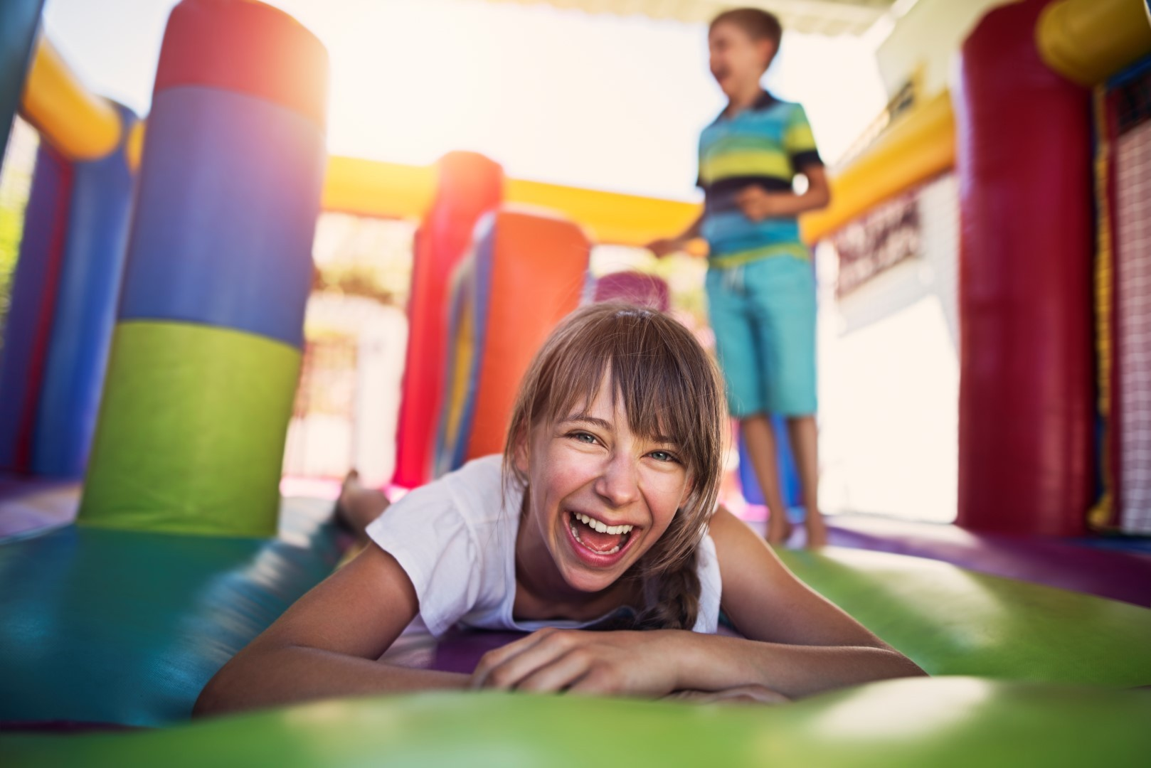Kids having fun in inflatable castle playground